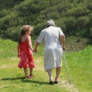 Photo: A child an an old lady are walking together
