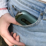 Photo: Cell phone looming out of the trouser pocket