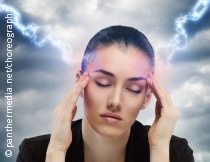 Photo: Woman with strong headaches