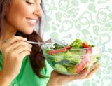 Photo: Woman eating a salad