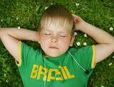 Photo: Kid sleeping on grass