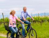 Photo: Older couple cycling