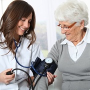 Photo: Doctor checking a patient's blood pressure
