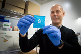 Greg Wolters, CEO of SCHOTT MINIFAB with the 20 Millionth TearLab Osmolarity Test Card prior to shipping.